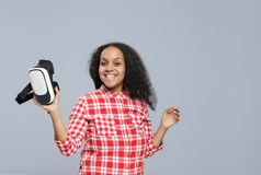 Young Woman Hold Virtual Reality Digital Glasses African American Girl Happy Smile. Isolated Over Gray Background Royalty Free Stock Image