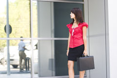 Young woman holdig briefcase Royalty Free Stock Photography
