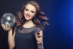 Free Young Woman Holding A Glass Of Wine And Disco Ball At Night Club Royalty Free Stock Photography - 110514277