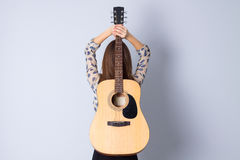 Free Young Woman Holding A Guitar Stock Photos - 79572593