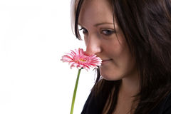 Young Woman Holding A Pink Flower Stock Photography