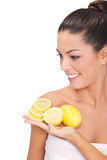 Young Woman Holding A Slice Of Lemons Royalty Free Stock Photo