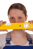 Young Woman Holding A Spirit Level Royalty Free Stock Photos