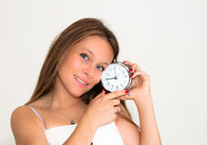 Young woman holding alarm clock Royalty Free Stock Photography