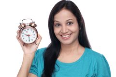 Young woman holding alarm clock Stock Photos