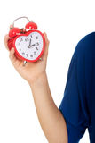 Young woman holding alarmclock. Stock Images
