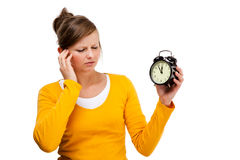 Young woman holding alrm clock Royalty Free Stock Images
