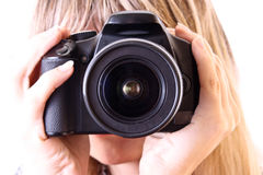 Young woman holding amateour camera Royalty Free Stock Photos