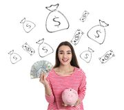 Woman holding American dollars and piggy bank against white background with drawn money. Young woman holding American dollars and piggy bank against white stock photos