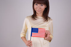 Young woman holding American Flag. Waist of of young Asian woman holding American Flag Royalty Free Stock Photo