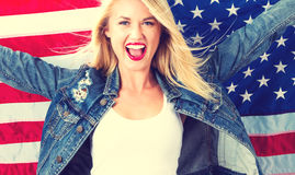 Young woman holding American flag Stock Photos