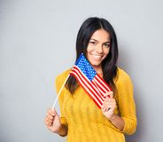 Young woman holding american flag Stock Image