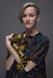 Young woman holding anaconda Stock Photos