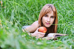 Young woman holding apple Stock Image
