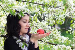Young woman holding apple Stock Photo