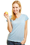 Young woman holding an apple royalty free stock photos