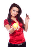 Young woman holding apple and chocolates Royalty Free Stock Photography