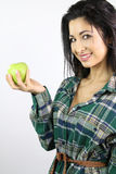 Young woman holding an apple Stock Photo