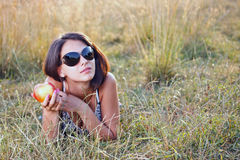 Young woman holding apple in her hand Stock Photo