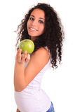 Young woman holding apple. Isolated over white Royalty Free Stock Photo