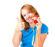 Young woman holding apple and measuring tape. Portrait of a young sport woman holding apple and measuring tape over white background Stock Photos
