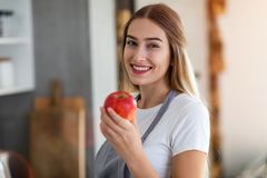Young woman holding an apple stock image