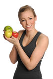 Young Woman Holding Apples Stock Photos