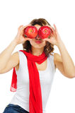 Young woman holding apples fruit for her eyes Stock Photography
