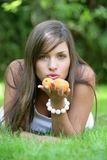 Young woman holding apricots Stock Photo