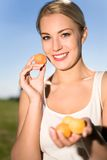 Young woman holding apricots Royalty Free Stock Images