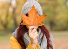Young woman holding autumn leaf Royalty Free Stock Photography