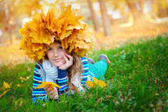 Young woman holding autumn leaves.  royalty free stock photos