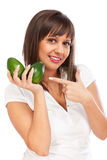 Young woman holding avocado Royalty Free Stock Photography