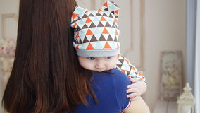 Young woman holding baby boy in her arms stock footage