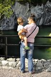 Young woman holding baby boy on Karelian Marble canyon Stock Photography