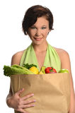 Young Woman Holding Bag of Groceries Stock Photo