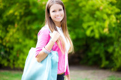 Young woman holding a bag at the park Stock Photos