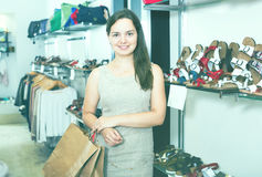 Young woman holding bags in shoes store Stock Photo