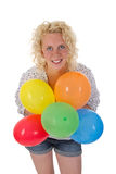 Young woman holding balloons. Young blonde woman holding balloons in her hand Stock Photography