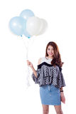 Young woman holding balloons. Young woman holding balloons isolated on white background lifestyle concept Stock Image