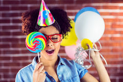 Young woman holding balloons and lollipop Royalty Free Stock Photos
