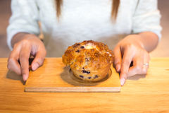 Young woman holding banana muffins Stock Photo