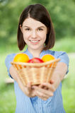 Young woman holding a basket Stock Photography