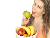 Young Woman Holding a Basket of Fresh Fruit Royalty Free Stock Photos