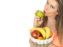 Young Woman Holding a Basket of Fresh Fruit Stock Images