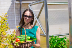 Young woman holding a basket of greenery and onion Royalty Free Stock Image