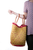 Young woman holding a basket and a mobile phone Royalty Free Stock Photo