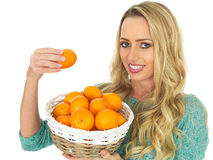 Young Woman Holding a Basket of Tangerines Royalty Free Stock Photo