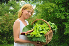 Young woman holding basket with vegetable. Outdoor Royalty Free Stock Photos