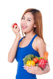 Young woman holding basket of vegetables. Stock Image